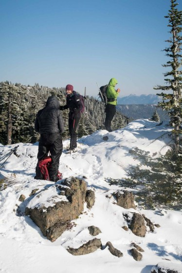 three people on the high point of the ridge to Genesis Mountain