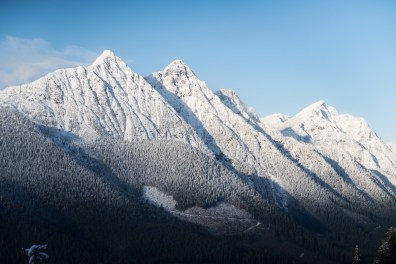 Snow capped Mount Ashwood and Bonanza Peak, shot from Mount Elliot on Vancouver Island