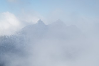 Mount Ashwood and Bonanza Peak shrouded in cloud, picture shot from Mount Elliot