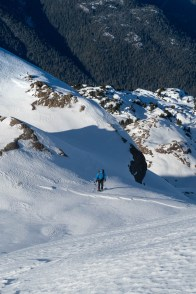 Rick after chopping through a small cornice, standing on the summit ridge of dder Mountain