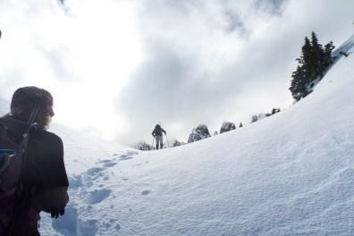 snowshoeing up to the ridge in the Mackenzie Range