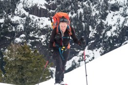 a woman climbing up to the Mackenzie Range while hiking on Vancouver Island