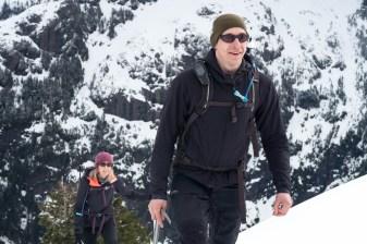 Man and woman climbing a mountain