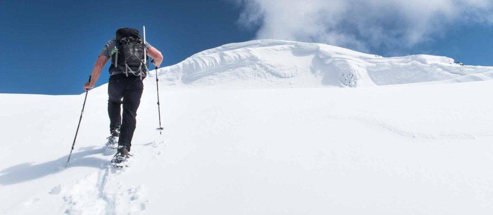 a man ascending snow