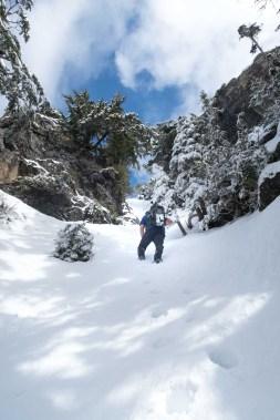 Phil ascending the gully to Canoe Peak