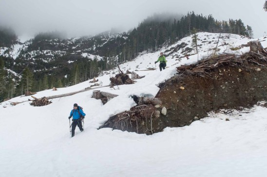 men walking down a melting snow slope