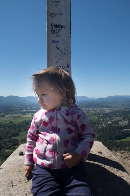 Octavia inspects the cliff edge at the cross on Mount Tzouhalem: What's down there?