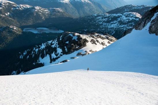 a man descending from Big Interior Mountain in Strathcona Park