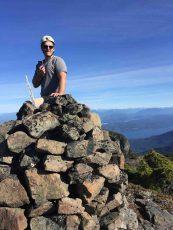a man on a summit cairn