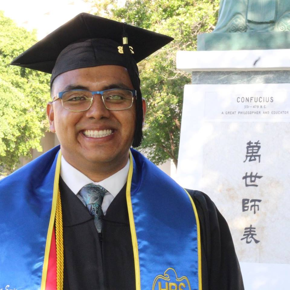 Image: Young man in graduation uniform