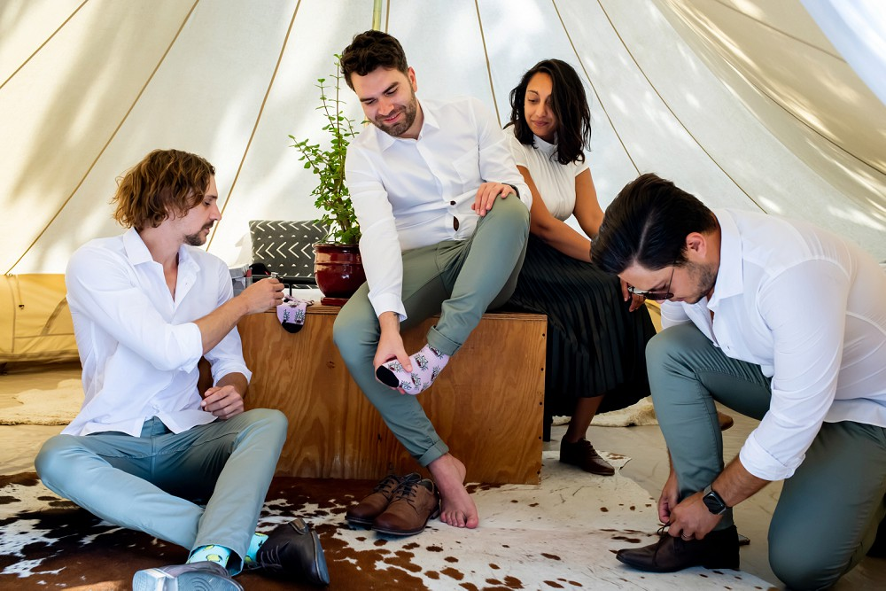 Cherry Glamping wedding groom getting ready in tent