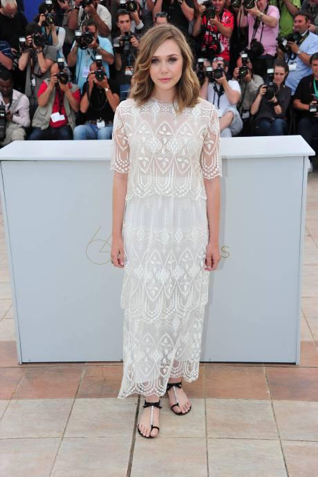 Elizabeth Olsen wearing The Row at the 2011 Cannes Film Festival on exshoesme.com.