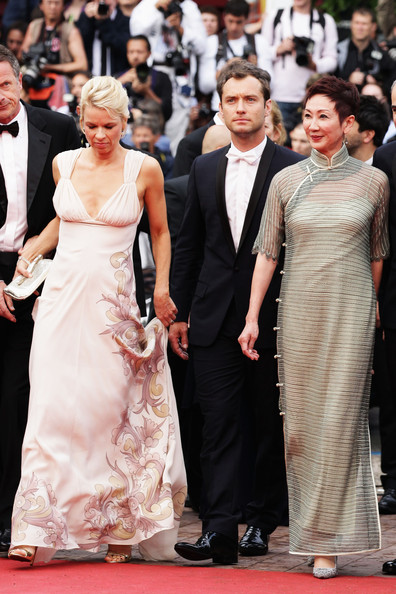 Nansun Shi with Liv Ullmann and Jude Law at the 2011 Cannes Film Festival on exshoesme.com.