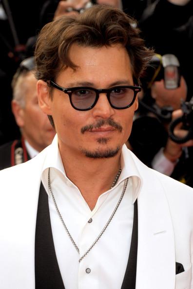 Johnny Depp at the 2011 Cannes Film Festival on exshoesme.com.