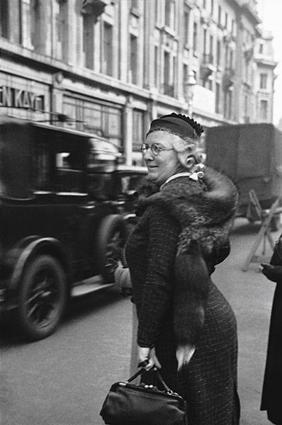 Woman in mink stole shopping in Oxford Street, London, 1934 by E.O. Hoppé on exshoesme.com