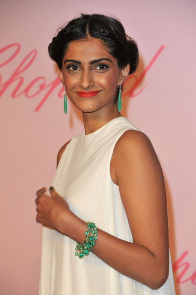 Sonam Kapoor in green and white at the 2011 Cannes Film Festival on exshoesme.com