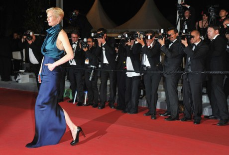 Tilda Swinton walks away from photographers at the 2011 Cannes Film Festival on exshoesme.com.
