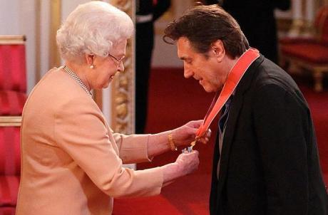 Bryan Ferry receiving a CBE from Queen Elizabeth II on November 30, 2011 on Exshoesme.com