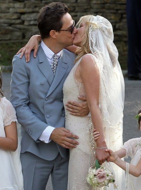 Kate Moss kisses her husband Jamie Hince at their wedding on Exshoesme.com