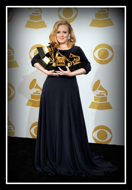 Adele carrying her six awards, wearing Burberry at the 2012 Grammy Awards on Exshoesme.com