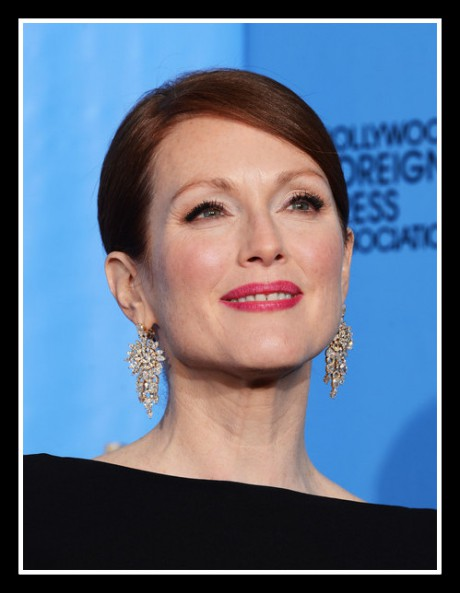 Julianne Moore is a glow in the press room at the 2013 Golden Globe Awards on Exshoesme.com. Photo Kevin Winter