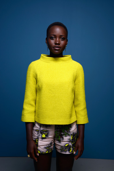 Lupita Nyong'o in the Guess Portrait Studio at the 2013 Toronto International Film Festival #TIFF13 on Exshoesme.com. Larry Busacca photo