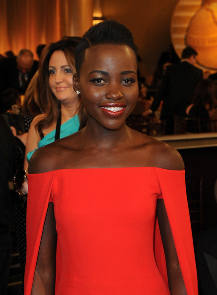 Lupita Nyong'o in Ralph Lauren during the 2014 Golden Globe Awards on Exshoesme.com. Kevin Winter photo.