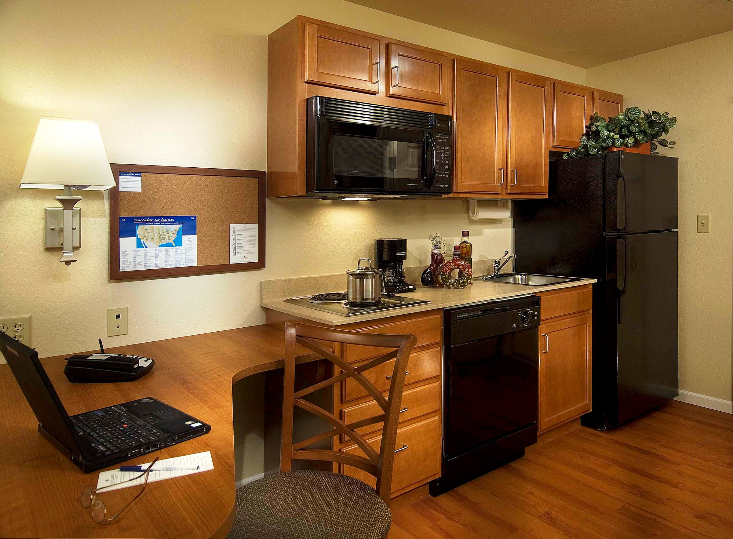 hotels with kitchen cabinets light wood what is an extended stay hotel stayer weekly