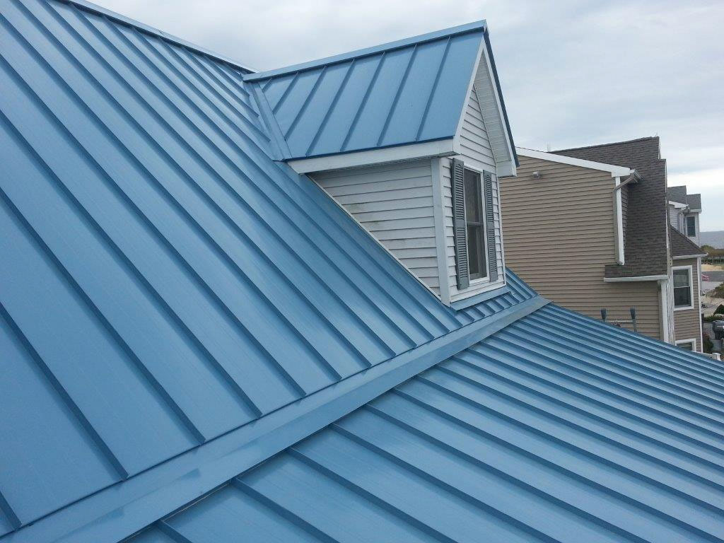 The beauty of metal roofs!  Exterior Renovations Madison