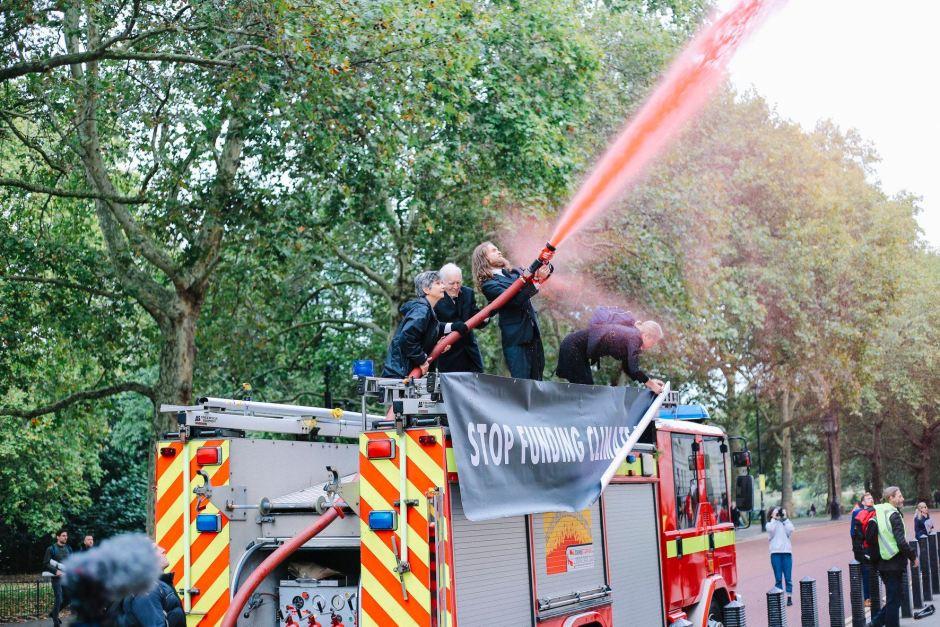 Extinction Rebellion spray fake blood on Treasury using fire engine, Fire Hose in hands of Mark Øvland