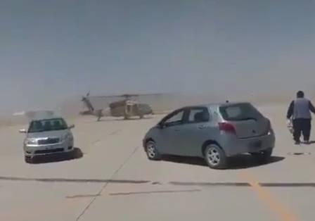 Taliban surround an abandoned Black Hawk in Kandahar