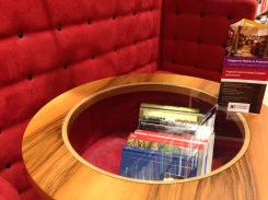 Books hidden inside the cafe tables.