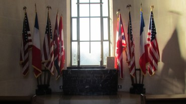 Flags standing beside the altar in the chapel.