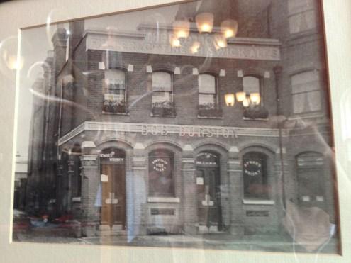 Pardon the reflection, but the historic pub.