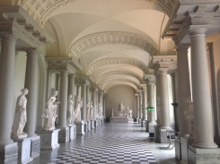 The long corridor full of marble statues.