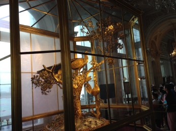 The golden peacock clock inside The Hermitage.