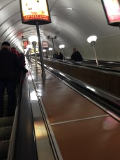 Going up the longest escalator in the world.