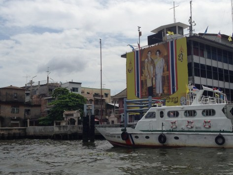 Traveling down the Chao Phraya River with images of the king along the way.