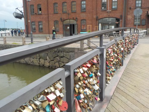 A classic love lock bridge at the base of Uspenski Cathedral.