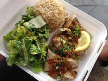 Ahi tuna with brown rice and salad, enjoyed in the pouring rain.