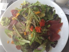 A sashimi salad with garden flowers.