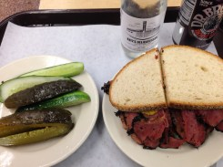 Pastrami on rye with pickles and seltzer. The New York way.