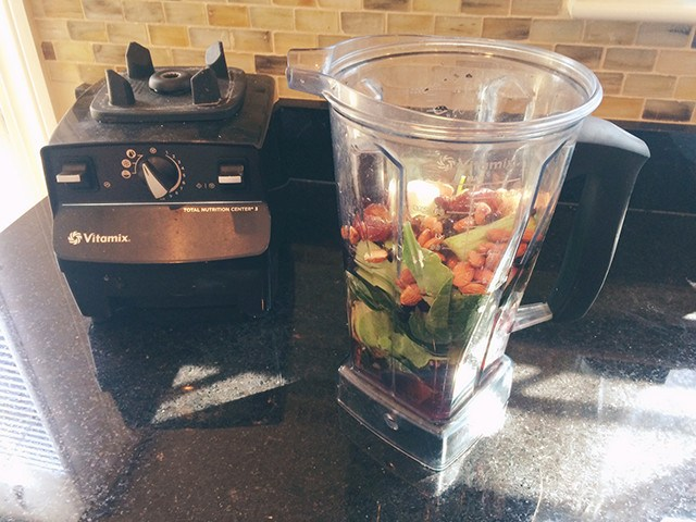 Vitamix recovery drinks from the blender with vegetables and fruits