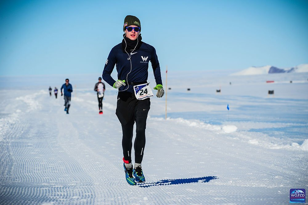 Greg Nance running on the ice of Antartica during the World Marathon Challenge.