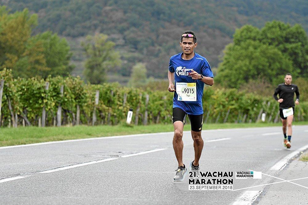 man running a marathon on a road