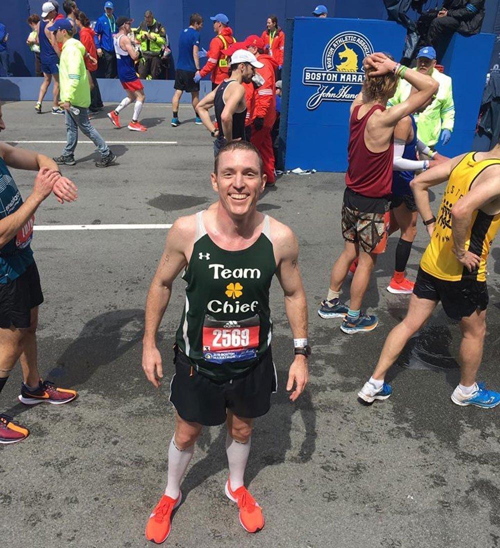 runner standing at finish line boston marathon