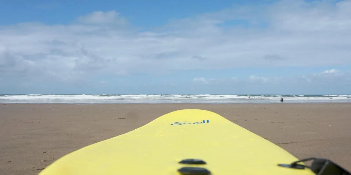 Where to get surfing lessons in Swansea Bay