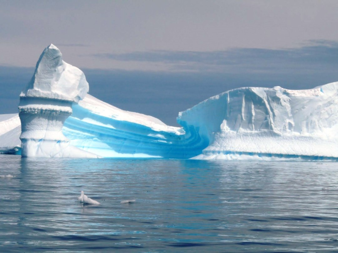 An iceberg in the shape of an ice cream cone.
