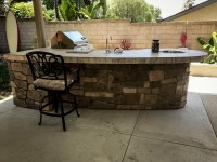 Custom Outdoor Kitchen with Rock - Extreme Backyard Designs