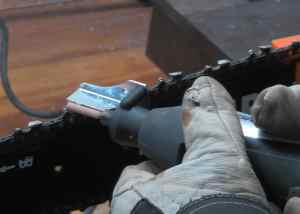 sharpening the chainsaw with dremel